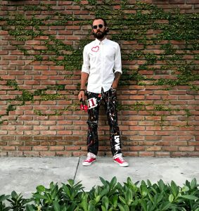Do What You Love hand painted pants by Sergey Gordienko
